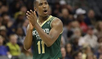 In this photo taken Tuesday, Nov. 21, 2017, Sacramento State guard Kevin Hicks encourages a teammate during the second half of an NCAA college basketball game against UC Davis, in Sacramento, Calif. Hicks broke down in his first trip back to the 9th Ward of New Orleans since Hurricane Katrina uprooted his family. The bones are what hit Hicks. Not the house that was destroyed, not the devastation still apparent three years later, not the clothes wadded up in the corner of what was once his bedroom. No, the bones of the family dog scattered in the yard are what did it. (AP Photo/Rich Pedroncelli)