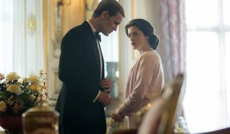 """In this image released by Netflix, Claire Foy, right, and Matt Smith in a scene from """"The Crown,"""" premiering its second season on Friday,  (Robert Viglasky/Netflix via AP)"""