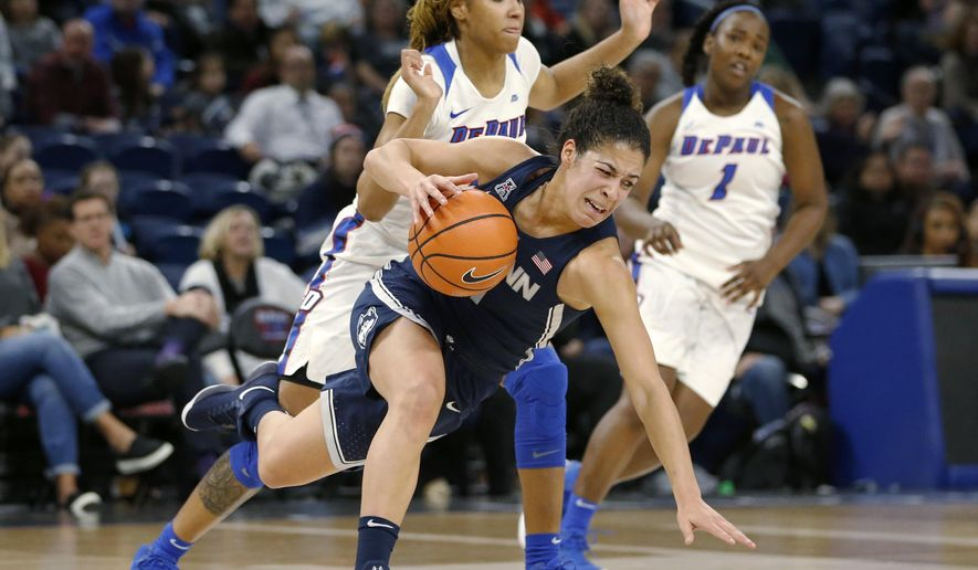 Connecticut guard Kia Nurse, front, is tripped by DePaul forward Mart'e Grays during the first half of an NCAA college basketball game Friday, Dec. 8, 2017, in Chicago. (AP Photo/Charles Rex Arbogast)