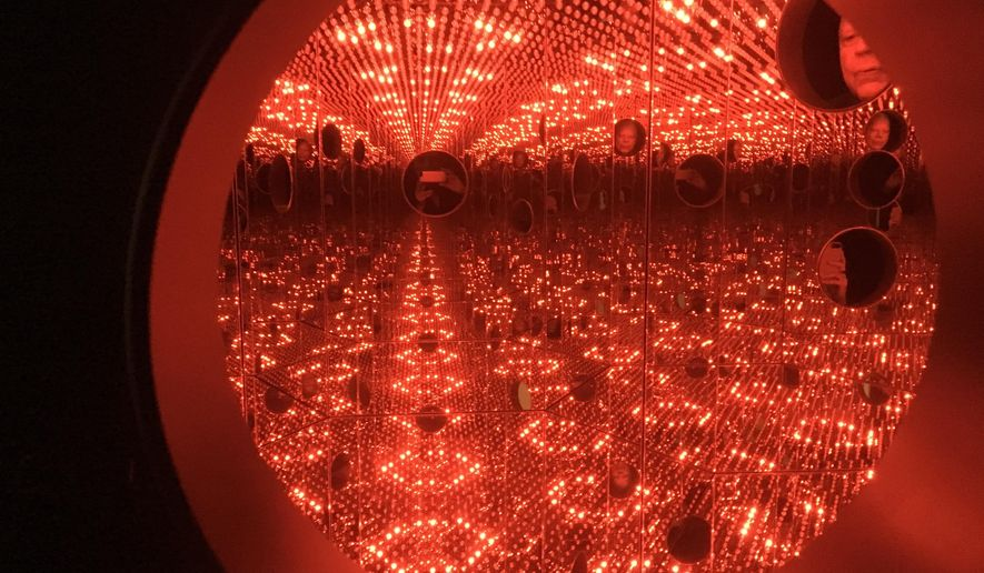"""In this Nov. 21, 2017 photo, colored lights appear in the Infinity Mirror Room created by Japanese artist Yayoi Kusama, part of the exhibit, """"Yayoi Kusama: Festival of Life,"""" on display at the David Zwirner gallery in the Chelsea section of New York. The exhibit runs through Dec. 16. (AP Photo/Jocelyn Noveck)"""