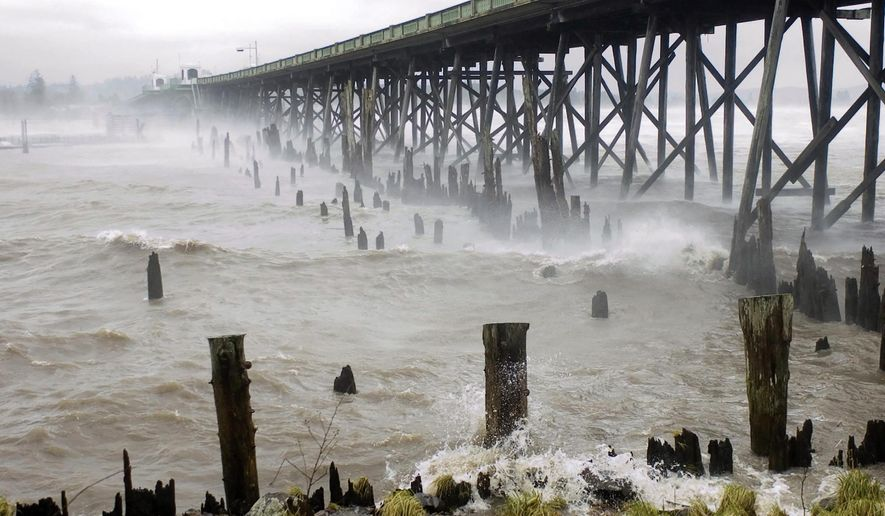 In this Dec. 3, 2007, photo, spray from wind driven waves whips beneath the Old Young's Bay Bridge at the Astoria Yacht Club in Astoria, Ore. (Alex Pajunas/Daily Astorian via AP)