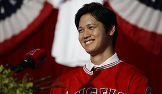 Baseball player Shohei Ohtani, from Japan, smiles during a news conference at Angel Stadium, Saturday, Dec. 9, 2017, in Anaheim, Calif. Ohtani, who intends to be both a starting pitcher and an everyday power hitter, turned down interest from every other big-league club to join two-time MVP Mike Trout and slugger Albert Pujols with the Angels, who are coming off their second consecutive losing season and haven't won a playoff game since 2009. (AP Photo/Jae C. Hong)