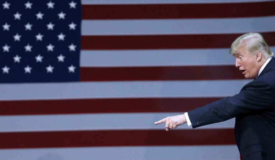 President Donald Trump points to the crowd after a rally in Pensacola, Fla., Friday, Dec. 8, 2017. (AP Photo/Jonathan Bachman)