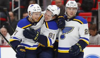 St. Louis Blues' Vladimir Sobotka, from left, celebrates his goal against the Detroit Red Wings with teammates Vladimir Tarasenko (91) and Vince Dunn (29) during the second period of an NHL hockey game, Saturday, Dec. 9, 2017, in Detroit. (AP Photo/Paul Sancya)