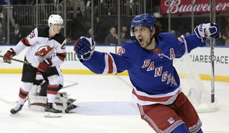 New York Rangers right wing Mats Zuccarello (36) celebrates his goal as New Jersey Devils defenseman Damon Severson (28) reacts during the second period of an NHL hockey game Saturday, Dec. 9, 2017, at Madison Square Garden in New York. (AP Photo/Bill Kostroun)