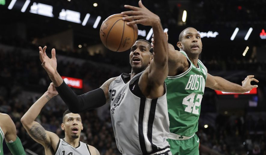 San Antonio Spurs forward LaMarcus Aldridge (12) and Boston Celtics forward Al Horford (42) reach for a rebound during the first half of an NBA basketball game Friday, Dec. 8, 2017, in San Antonio. (AP Photo/Eric Gay)