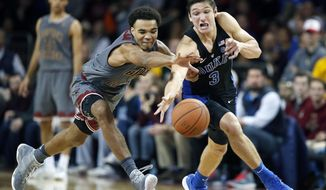 Boston College's Jerome Robinson (1) and Duke's Grayson Allen (3) chase a loose ball during the second half of an NCAA college basketball game in Boston, Saturday, Dec. 9, 2017. (AP Photo/Michael Dwyer)