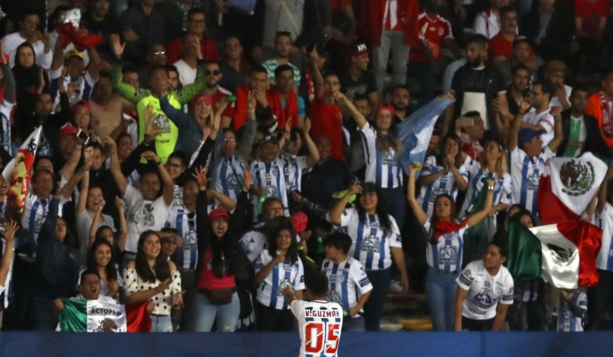 Mexico's Pachuca Victor Guzman, center, celebrates after scoring his side's opening goal during the Club World Cup soccer match between Pachuca and Wydad Athletic Club at Zayed sport city in Abu Dhabi, United Arab Emirates, Saturday, Dec. 9, 2017. (AP Photo/Hassan Ammar)