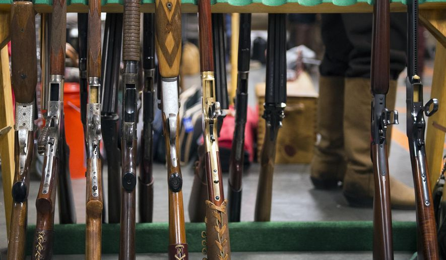ADVANCE  FOR RELEASE SATURDAY, DECEMBER 9, 2017 Guns await competition Sunday, Dec. 3, 2017, during the Shootout at Salt Creek an indoor cowboy action competition series held at the Nebraska Games and Parks Education Center. Competitors use Old West style pistols, rifles, and shotguns to complete the course of fire . (Kayla Wolf/The Journal-Star via AP)