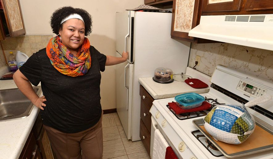 Jocelyn Morris was planning to cook food for holiday dinners for needy families in the kitchen of her Erie apartment, shown here Nov. 30, but Erie County Health Department regulations won't allow it. So Morris, 25, has found an inspected, commercial kitchen to use to cook the food for about 19 families that she plans to help this Christmas season. (Christopher Millette/Erie Times-News via AP)