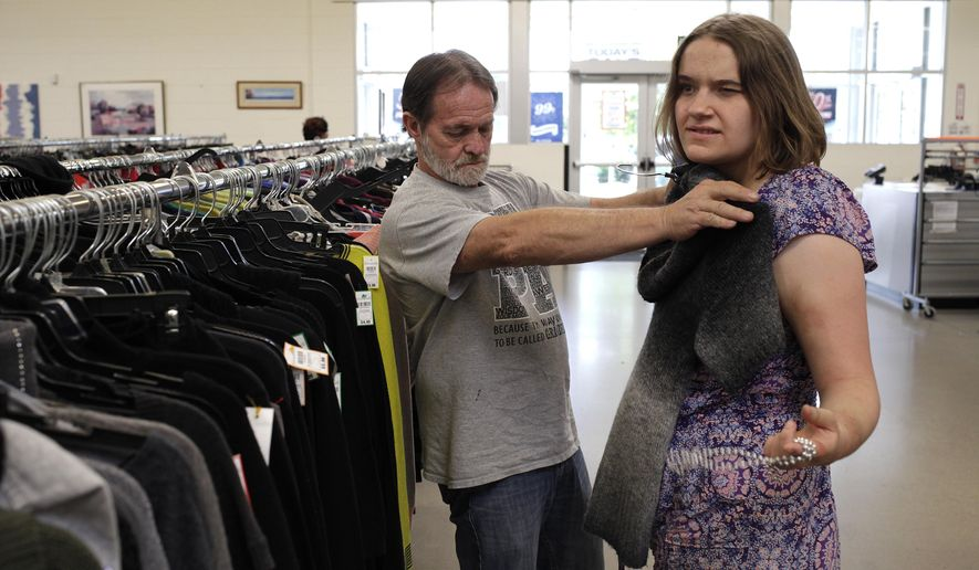 "In a Sept. 23, 2017 photo, Bernie Lierow picks out a new sweater for his daughter, Danielle ""Dani"" Lierow, during a nineteenth birthday outing in Murfreesboro, Tenn. Danielle was found by police in the back of a run-down house in Plant City, Fla., when she was almost 7.  For years, she had been kept behind a closed door, in a space the size of a walk-in closet, alone in the dark.  A new family adopted the girl in 2007, called her Dani, and tried to make up for years of neglect. (Laura Cerri/Tampa Bay Times via AP)"
