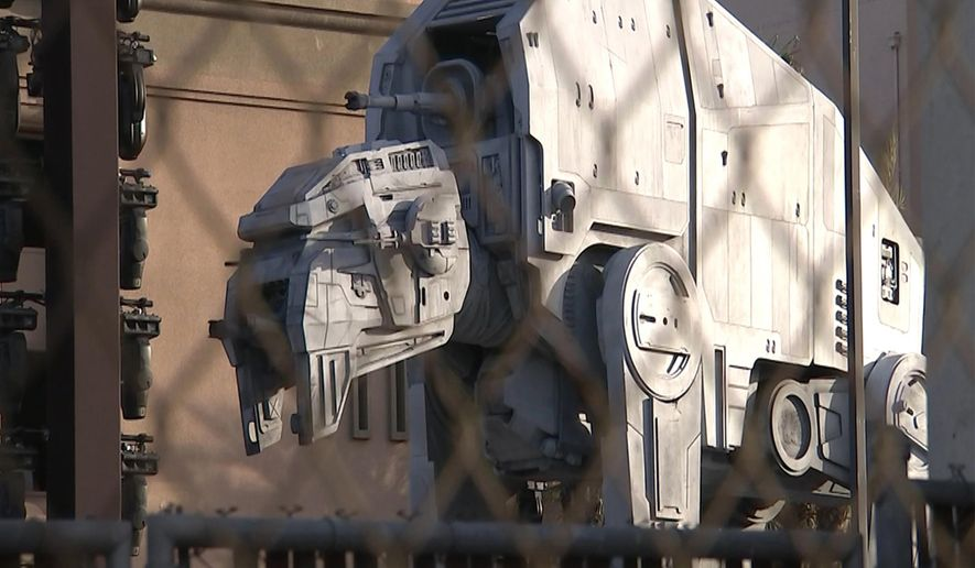 "In this still image taken from video, a giant assault vehicle and gun turrets towers over the carpet at the Shrine Auditorium where guests will make their way into Saturday's world premiere of ""Star Wars: The Last Jedi,"" in downtown Los Angeles, Friday, Dec. 8, 2017. ""The Last Jedi"" is one of the year's biggest releases. (AP Photo/Rick Taber)"
