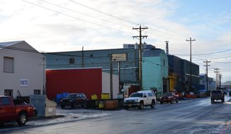 In this Nov. 30, 2017, photo, a stretch of Shelikoff Street, which is known locally as 'Cannery Row' is shown in Kodiak, Alaska. Kodiak's seafood processors are facing staff shortages as older employees reach retirement age and a younger generation is showing little interest in joining the workforce. (Alistair Gardiner/Kodiak Daily Mirror via AP)