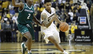 Missouri's Blake Harris, right, drives around Green Bay's PJ Pipes during the first half of an NCAA college basketball game Saturday, Dec. 9, 2017, in Columbia, Mo. (AP Photo/Jeff Roberson)
