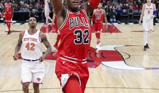 Chicago Bulls guard Kris Dunn goes up for a dunk against the New York Knicks during the first half of an NBA basketball game, Saturday, Dec. 9, 2017, in Chicago. (AP Photo/Kamil Krzaczynski)