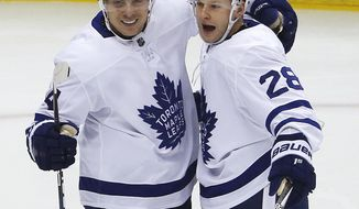 Toronto Maple Leafs' Connor Brown (28) celebrates his goal with Auston Matthews (34) in the first period of an NHL hockey game against the Pittsburgh Penguins in Pittsburgh, Saturday, Dec. 9, 2017. (AP Photo/Gene J. Puskar)