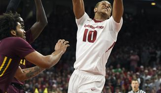 Arkansas forward Daniel Gafford drives to the hoop past the Minnesota defense in the first half of an NCAA college basketball game Saturday, Dec. 9, 2017 in Fayetteville, Ark. (AP Photo/Michael Woods)