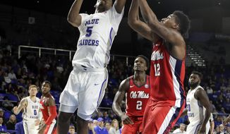 Middle Tennessee forward Nick King (5) scores against Mississippi forward Bruce Stevens (12) during the second half of an NCAA college basketball game Saturday, Dec. 9, 2017, in Murfreesboro, Tenn. Middle Tennessee won 77-58. (AP Photo/Mark Humphrey)