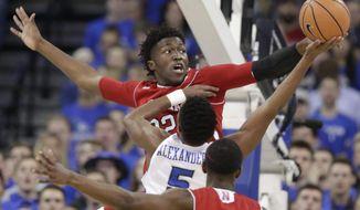 Nebraska's Jordy Tshimanga (32) blocks a layup by Creighton's Ty-Shon Alexander (5) during the first half of an NCAA college basketball game in Omaha, Neb., Saturday, Dec. 9, 2017. (AP Photo/Nati Harnik)