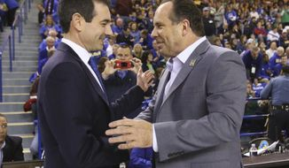 Delaware coaches present, Martin Ingelsby, left, and past, Mike Brey, greet each other before the team's NCAA college basketball game against Notre Dame on Saturday, Dec. 9, 2017, in Newark, Del. (William Bretzger/The Wilmington News-Journal via AP)