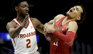 Oklahoma guard Trae Young, right, and Southern California guard Jonah Mathews vie for a loose ball during the first half of an NCAA college basketball game in Los Angeles, Friday, Dec. 8, 2017. (AP Photo/Chris Carlson)