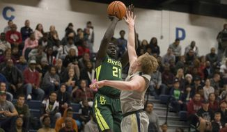 Baylor forward Nuni Omot (21) shoots over Randall guard Brad Ficken in the first half of an NCAA college basketball game in Fort Hood, Texas, Saturday, Dec. 9, 2017. (AP Photo/Stephen Spillman)