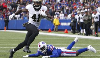 FILE - In this Nov. 12, 2017, file photo, New Orleans Saints running back Alvin Kamara (41) rushes past Buffalo Bills' Shareece Wright (20) during the first half of an NFL football game in Orchard Park, N.Y.  Rookies are contributing as much, or more, than ever in the NFL nowadays. With players such as Alvin Kamara making an immediate impact, this season's first-year class ranks among the strongest since 2000.(AP Photo/Jeffrey T. Barnes, File)