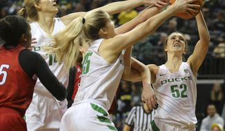 Oregon's Lydia Giomi (14), Anneli Maley (15) and Sierra Campisano (52) chase an offensive rebound during an NCAA college basketball game against Southern Utah in Eugene, Ore., Saturday, Dec. 9, 2017. (Brian Davies/The Register-Guard via AP)