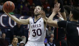 Saint Mary's Jordan Ford (30) shoots against Seattle's Scott Ulaneo, right front, during the second half of an NCAA college basketball game Saturday, Dec. 9, 2017, in Moraga, Calif. (AP Photo/Ben Margot)