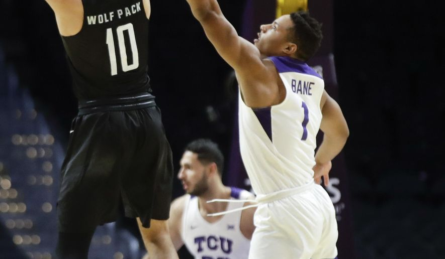 Nevada forward Caleb Martin, left, shoots over TCU guard Desmond Bane during the first half of an NCAA college basketball game in Los Angeles, Friday, Dec. 8, 2017. (AP Photo/Chris Carlson)