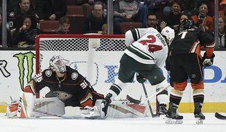 Minnesota Wild defenseman Matt Dumba (24) scores on Anaheim Ducks goalie John Gibson during overtime of an NHL hockey game in Anaheim, Calif., Friday, Dec. 8, 2017. The Wild won 3-2. (AP Photo/Kelvin Kuo)