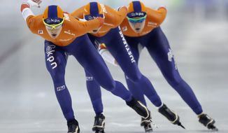 Marrit Leenstra, left, of the Netherlands, leads her team during the women's team pursuit competition at a World Cup speedskating event Friday, Dec. 8, 2017, in Kearns, Utah. (AP Photo/Rick Bowmer)