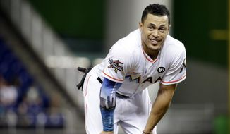 FILE - In this Aug. 14, 2017, file photo, Miami Marlins' Giancarlo Stanton stands on the field during a baseball game against the San Francisco Giants in Miami.  A person familiar with the negotiations says the New York Yankees and Miami Marlins are working on a trade that would send slugger Giancarlo Stanton to New York and infielder Starlin Castro to Miami.  The person spoke to The Associated Press on condition of anonymity Saturday, Dec. 9, 2017, because no agreement has been completed. (AP Photo/Lynne Sladky, File) **FILE**