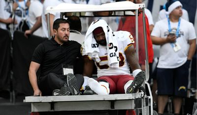 "Washington Redskins linebacker Zach Brown leaves after spraining his right foot Sunday. ""That field's horrible,"" Brown said of a StubHub Center made for soccer. (Associated Press)"