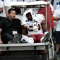 """Washington Redskins linebacker Zach Brown leaves after spraining his right foot Sunday. """"That field's horrible,"""" Brown said of a StubHub Center made for soccer. (Associated Press)"""