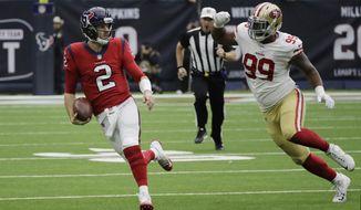 Houston Texans quarterback T.J. Yates (2) scramble as San Francisco 49ers defensive tackle DeForest Buckner (99) pressures him during the first half of an NFL football game, Sunday, Dec. 10, 2017, in Houston. (AP Photo/David J. Phillip)