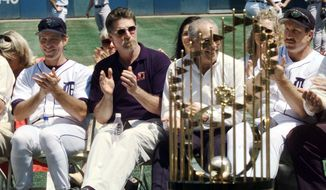 With the World Series Trophy on display, Alan Trammell, from left, Jack Morris, general manager Bill Lajoie and Lance Parrish, members of the 1984 World Series Championship team, are honored in a 15th anniversary ceremony before the Tigers game Sunday, July 25, 1999, in Detroit. (AP Photo/Duane Burleson) **FILE**
