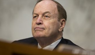 In this June 21, 2016, file photo, Sen. Richard Shelby, R-Ala., listens at a U.S. monetary policy meeting on Capitol Hill in Washington. Most statewide Republican officeholders in Alabama say they're voting for Roy Moore for U.S. Senate. But the state's senior U.S. senator, Shelby, didn't vote for Moore. (AP Photo/Evan Vucci, File)