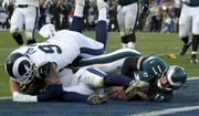 Philadelphia Eagles quarterback Carson Wentz gets tackles during the second half of an NFL football game against the Los Angeles Rams Sunday, Dec. 10, 2017, in Los Angeles. Wentz left the game shortly after the play and did not return to the game. (AP Photo/Mark J. Terrill)
