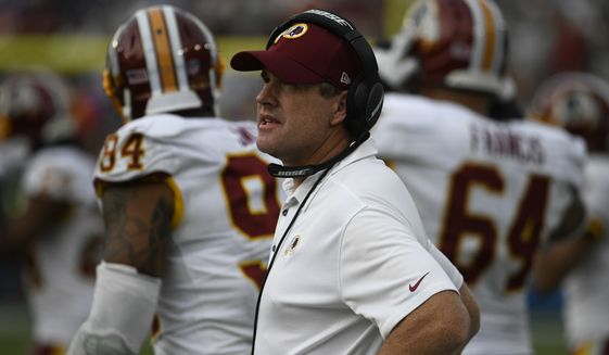 Washington Redskins head coach Jay Gruden looks on during the second half of an NFL football game against the Los Angeles Chargers, Sunday, Dec. 10, 2017, in Carson, Calif. (AP Photo/Denis Poroy)