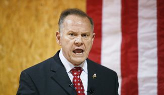 In this Nov. 30, 2017, file photo, former Alabama Chief Justice and U.S. Senate candidate Roy Moore speaks at a campaign rally, in Dora, Ala. Polls show Moore in a tight race with Democrat Doug Jones. (AP Photo/Brynn Anderson, File)