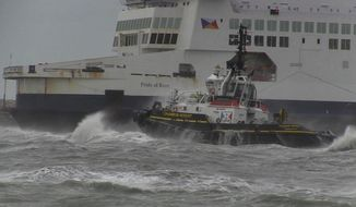 In this grab taken from video, a tug boat tries to tow The Pride of Kent ferry, in Calais, France, Sunday, Dec. 10, 2017.  Authorities prepared the emergency evacuation of a ferry carrying 313 people that ran aground at the French port city of Calais Sunday interrupting boat traffic across the English Channel, according to authorities. (AP)