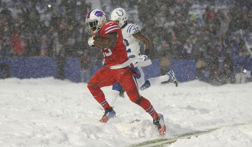 Buffalo Bills running back LeSean McCoy scores a touchdown during the overtime of an NFL football game against the Indianapolis Colts, Sunday, Dec. 10, 2017, in Orchard Park, N.Y. The Bills beat the Colts 13-7. (AP Photo/Adrian Kraus)