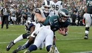 Philadelphia Eagles quarterback Carson Wentz gets tackles during the second half of an NFL football game against the Los Angeles Rams Sunday, Dec. 10, 2017, in Los Angeles. Wentz left the game shortly after the play and did not return to the game. (AP Photo/Mark J. Terrill) **FILE**