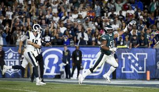 Philadelphia Eagles defensive end Brandon Graham, right, scores past Los Angeles Rams quarterback Jared Goff on a fumble during the second half of an NFL football game Sunday, Dec. 10, 2017, in Los Angeles. (AP Photo/Kelvin Kuo)