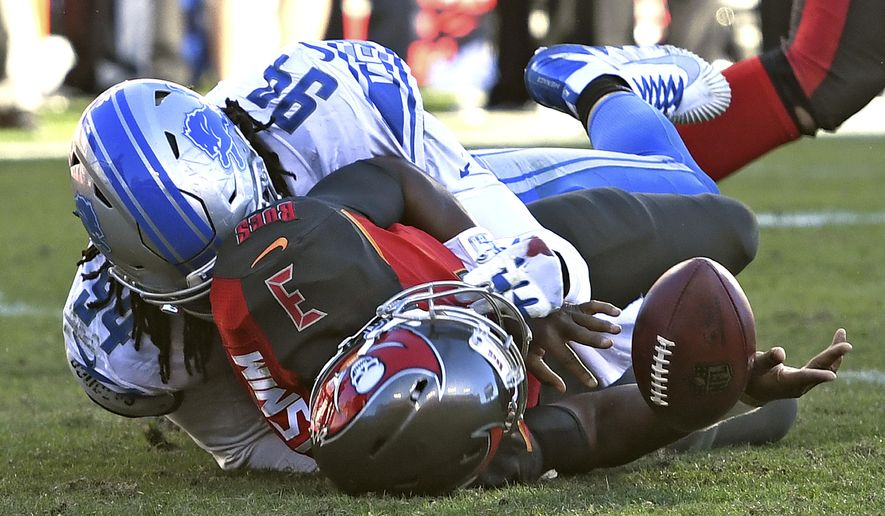 Tampa Bay Buccaneers quarterback Jameis Winston (3) fumbles the football after getting hit by Detroit Lions defensive end Ezekiel Ansah (94) during the second half of an NFL football game Sunday, Dec. 10, 2017, in Tampa, Fla. The Lions won the game 24-21. (AP Photo/Jason Behnken)