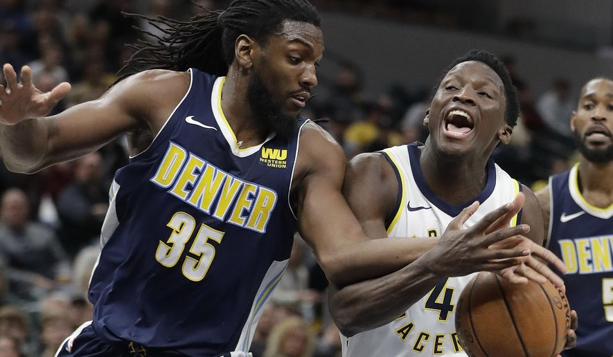 Indiana Pacers' Victor Oladipo (4) is fouled by Denver Nuggets' Kenneth Faried during the second half of an NBA basketball game, Sunday, Dec. 10, 2017, in Indianapolis. (AP Photo/Darron Cummings)