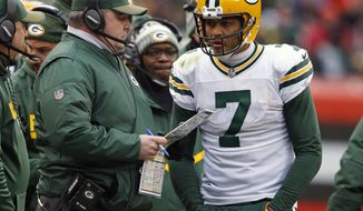 Green Bay Packers head coach Mike McCarthy, left, talks with quarterback Brett Hundley in the second half of an NFL football game against the Cleveland Browns, Sunday, Dec. 10, 2017, in Cleveland. (AP Photo/Ron Schwane)