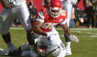 Kansas City Chiefs defensive lineman Chris Jones (95) sacks Oakland Raiders quarterback Derek Carr (4) during the first half of an NFL football game in Kansas City, Mo., Sunday, Dec. 10, 2017. (AP Photo/Ed Zurga)