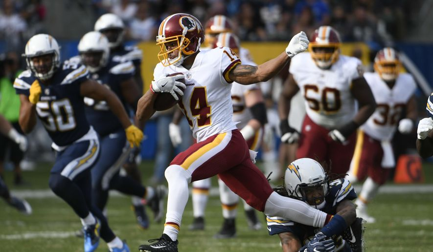 Washington Redskins wide receiver Ryan Grant gets away from Los Angeles Chargers safety Tre Boston, below, during the first half of an NFL football game Sunday, Dec. 10, 2017, in Carson, Calif. (AP Photo/Denis Poroy) **FILE**